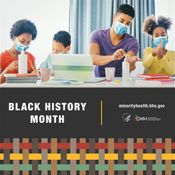 two adults and two children sitting at a table with masks on doing work on laptops over black history month