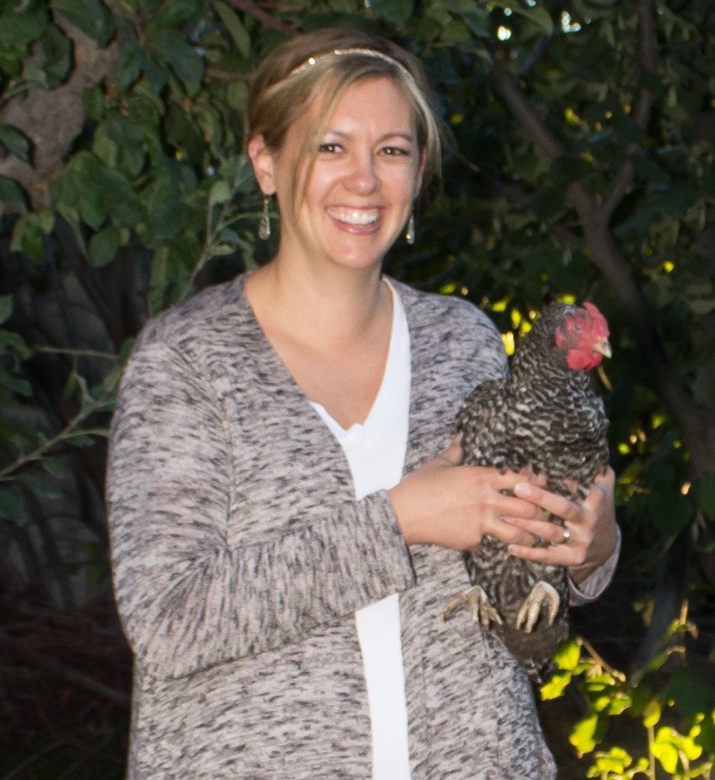 picture for Julie Atkinson, female, smiling, holding a chicken