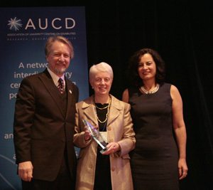 Joann Bodurtha (center) accepts the 2009 Outstanding Achievement Award with AUCD President Michael Gamel McCormick (left) and AUCD President-Elect Tamar Heller (right)