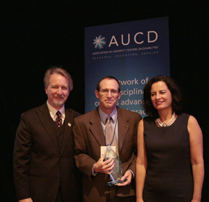 Paul Carbone (center) receives the 2009 Meritorious Service Award with AUCD President Michael Gamel McCormick (left) and AUCD President-Elect Tamar Heller (right)