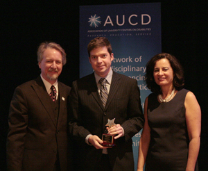 Ken DeGraff (center) receives the 2009 AUCD Gold Star Award with AUCD President Michael Gamel McCormick (left) and AUCD President-Elect Tamar Heller (right)