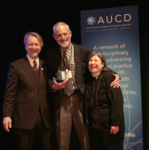Harold Kleinert, Director of the Human Development Institute (center) accepts the 2009 Young Professional Award on behalf of Kathleen Sheppard-Jones with AUCD President Michael Gamel McCormick (left) and AUCD Past- Past President Lu Zeph (right)