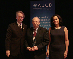 Mike Liebowitz, Director of the Munroe-Meyer Institute (center) accepts the 2009 Council on Community Advocacy Award with AUCD President Michael Gamel McCormick (left) and AUCD President-Elect Tamar Heller (right)