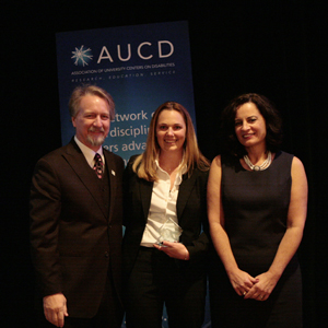 Shea Obremski (center) receives the 2009 Anne Rudigier Award with AUCD President Michael Gamel McCormick (left) and AUCD President-Elect Tamar Heller (right)