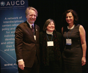 Lu Zeph (center) accepts the 2009 Distinguished Achievement Award with AUCD President Michael Gamel McCormick (left) and AUCD President-Elect Tamar Heller (right)