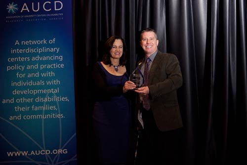David Morrissey accepts the 2010 AUCD International Service Award on behalf of Barbara LeRoy
