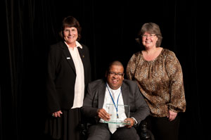 FCIC Assoc. Director Elizabeth Perkins and CAC Chair Damian Gregory with AUCD President Julie Fodor