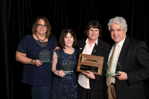 Julie Fodor (3rd from left) with outgoing AUCD Board members Amy Hewitt, Sandy Friedman, and Dan Crimmins