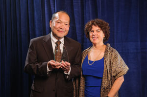 Award recipient Glen Fujiura and AUCD Board President Leslie Cohen