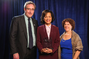 AUCD Executive Director Andy Imparato, Award recipient Harolyn Belcher and AUCD Board President Leslie Cohen