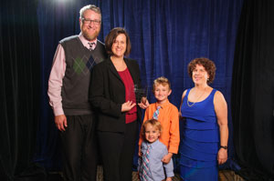 Award recipient Jessica Jagger with family and AUCD Boad President Leslie Cohen