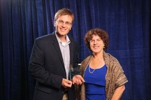 Award recipient Zachary Warren with AUCD Board Director Leslie Cohen