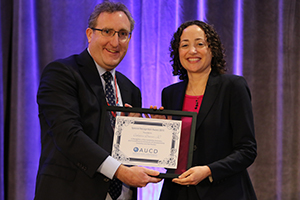 AUCD Executive Director Andy Imparato presents the award to Catherine Lhamon