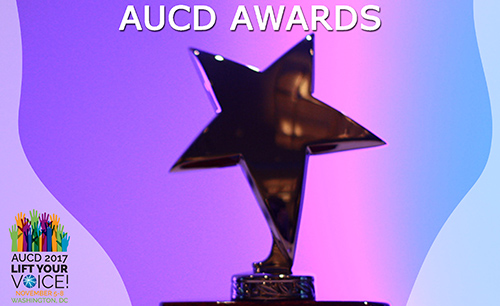 Photo of a gold star, presumably an award, on a purple background. Text: AUCD Awards. Includes AUCD 2017 conference logo in the bottom left corner.