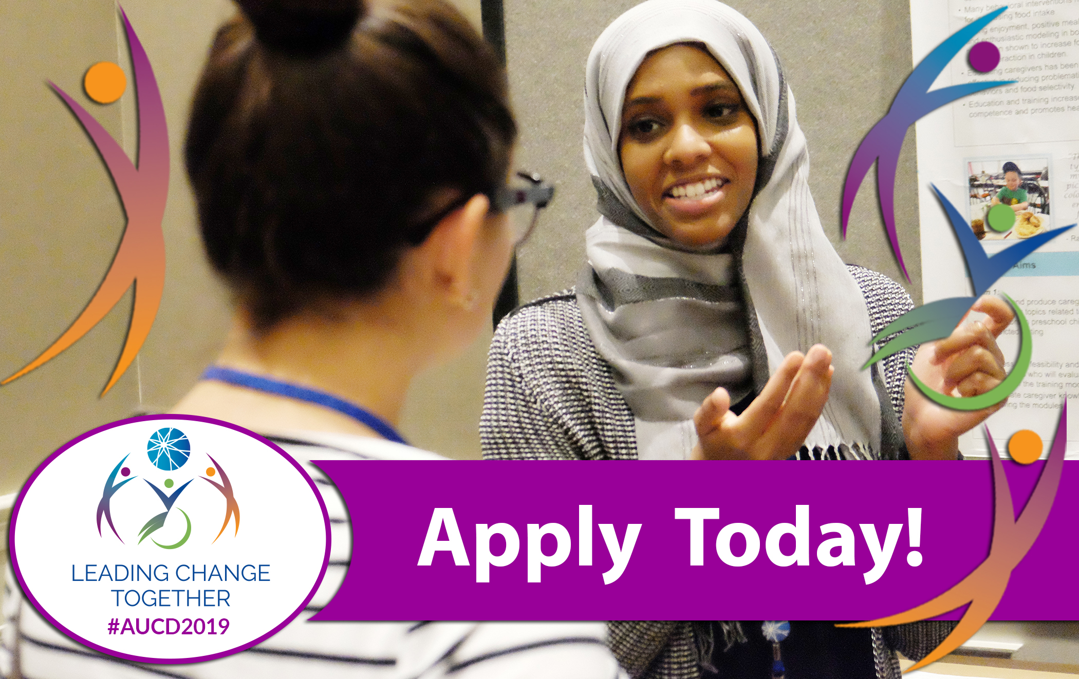 "Photo of a young woman in a headscarf smiling and talking to another young woman wearing glasses with her hair in a bun. Banner across the bottom says ""Apply Today"""