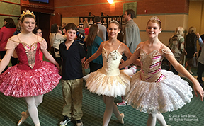 A photo ballet dancers with a young attendee