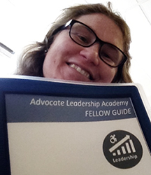NM LEND Self-Advocacy fellow Laurel Deans with binder from Advocate Leadership Academy