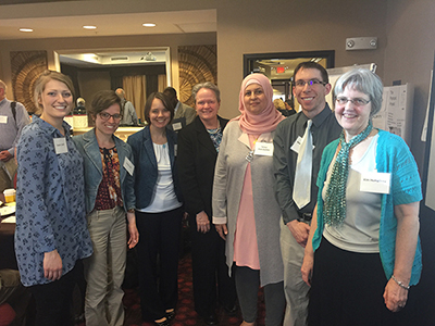 LEND Trainees and Faculty pose with Senator Shenna Bellows (third from left) and Kim Humphrey (far right.