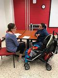 Ellyn McNamara, Disability Studies IL LEND Trainee, screening a child for ASD.