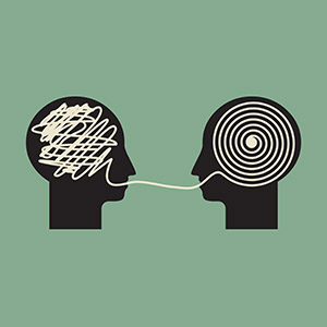 Icon of two silhouettes talking to each other. The first face has a messy swirled line in its brain. The line connects to the other head where it is a neat, swirl. Image represents communicating confusing information in a way that makes it clear.