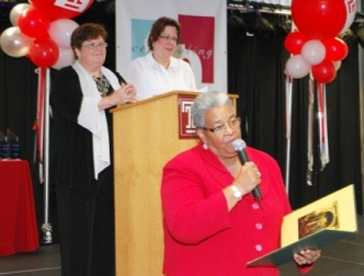 Honoree State Senator Shirley Kitchen reads a congratulatory proclamation from the Pennsylvania Senate to the Institute on Disabilities at Temple University, while co-executive directors Amy Goldman (left) and Celia Feinstein look on.