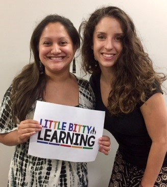 2 women holding a sign that says Little Bitty Learning