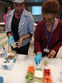 City of Jackson senior services staff Christi Johnson and Sharon Dallis take part in the snack preparation activity at the Flowood workshop