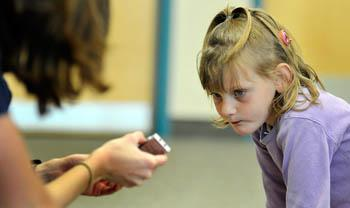 Margo Liechty, 5, listens to sounds played on a recorder by volunteer Liz Wilson in a class at the Listening in Cache Valley Sound Beginnings summer camp at Edith Bowen Laboratory School at Utah State University. (Alan Murray/Herald Journal)