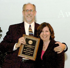 Dr. Fred Orelove is presented the award by Dr. Mary Hermann