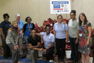 Child Thrive AmeriCorps Members with Nancy Keeler in front of completed summer supply kits.