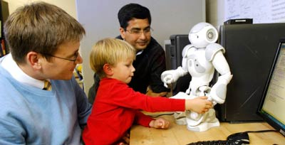 Researchers Zachary Warren and Nilanjan Sarkar are developing emotion-sensing robotic technology for use with people with autism spectrum disorder. (Anne Rayner / Vanderbilt)