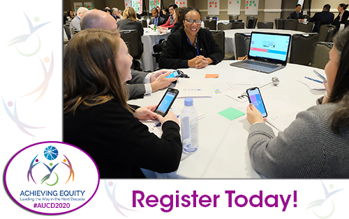 Image of conference attendees viewing a online tool with their smart phones